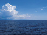 Serene Ocean and Vast Horizon under Cloudy Sky Photographic Print
