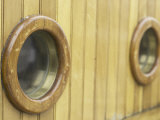 Detail of Porthole Windows on Wooden Surface of Sailboat Photographic Print