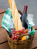Picnic Basket with Glassware and Picnic Foods Including Bread and Grapes with Wine Photographic Print
