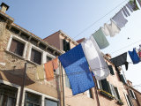 Lines of Laundry from Brick Houses Blowing in the Breeze Photographic Print