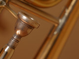 Close-Up of Shiny Brass Tubes and Mouthpiece of Trombone Photographic Print