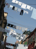 Laundry Hanging from Clotheslines Between Apartment Buildings Photographie