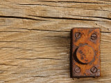 Close-Up of a Weathered and Worn Wood Surface with a Rusted Brass Hinge Photographic Print