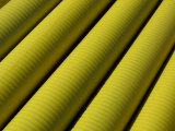 Diagonal Rows of Industrial Yellow Pipes Photographic Print