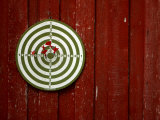 Old Dart Board Game Hanging on a Weathered Red Wall Photographic Print