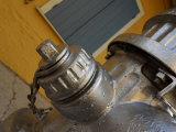 Cropped View of a Silver Fire Hydrant in New Orleans, Louisiana Photographic Print