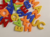 Pile of Multicolored Alphabet Magnets Photographic Print