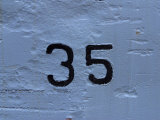 Number 35 Painted onto a White Wall Photographic Print