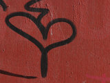 Graffiti on Red Concrete Wall Photographic Print