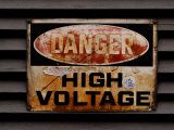 Weathered and Rusted Metal High Voltage Danger Sign Photographic Print