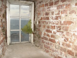 Weathered and Worn Brick Walls and Rustic Window Overlooking Ocean Photographic Print