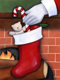 Hand of Santa Claus Placing Candy Cane in Stocking Photo