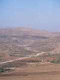 Picturesque View of a Barren Desert with a Road in Samaria, Israel Photographic Print