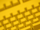 Yellow Tinted Computer Keyboard Photographic Print