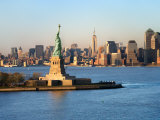 Historic Statue of Liberty in Front of the Skyline of Manhattan, New York Photographic Print