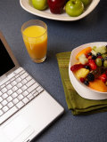 Fruit Salad with Orange Juice and Laptop Photographic Print