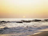 Peaceful Sunset over Waves Lapping in a Sea Photographic Print