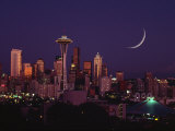 Buildings and Skyscrapers Illuminated at Night in Skyline in Seattle, Washington Photographic Print