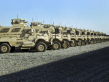 Mine Resistant Ambush Protected Vehicles Sit at Camp Liberty Photographic Print by  Stocktrek Images