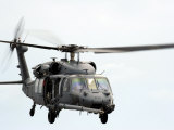HH-60 Pave Hawk Helicopter Conducts Search and Rescue Operations Photographic Print by  Stocktrek Images