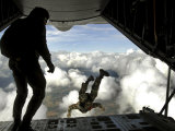 Pararescuemen Jump Out the Back of a C-130 Hercules Photographic Print by  Stocktrek Images