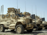 Mine Resistant Ambush Protected Vehicles Sit in the Parking Area at Joint Base Balad, Iraq Photographic Print by  Stocktrek Images
