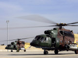 Two Iraqi MI-17 Hip Helicopters Conduct an Aeromedical Evacuation Mission Photographic Print by  Stocktrek Images