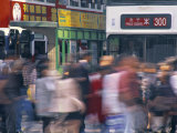 Pedestrians and Trams, Hong Kong, China Photographic Print by Neil Farrin