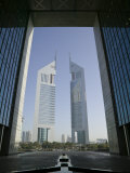 Emirates Towers Through Dubai International Financial Center Arch, Sheikh Zayed Road, Dubai, UAE Photographic Print by Walter Bibikow