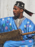 Whirling Dirvish Playes Instrument, Medina, Old City, Marrrakesh, Morocco Photographic Print by Jane Sweeney