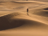 Tourist Running Along Sand Dunes, Tinfou Dunes, Morocco Photographic Print by Jane Sweeney