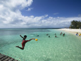 New Caledonia, Amedee Islet, Polynesian Kids Playing on Amedee Islet Beach Photographic Print by Walter Bibikow