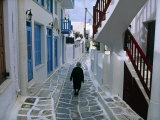 Woman Walking Down an Alley, Mykonos Town, Mykonos, Greece Photographic Print by Doug Pearson