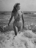 French Actress Barbara Laage Wearing Makeshift Two-Piece Bathing Suit Wading in Surf Lámina fotográfica de primera calidad por Nina Leen