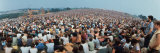 Seated Crowd Listening to Musicians Perform at Woodstock Music Festival Lámina fotográfica por John Dominis