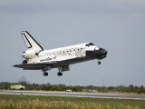Space Shuttle Discovery Approaches Landing on the Runway at the Kennedy Space Center Photographic Print by  Stocktrek Images