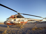 Iraqi Helicopter Sits on the Flight Deck Abandoned at Camp Warhorse Photographic Print by  Stocktrek Images