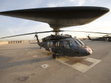 UH-60 Blackhawk Medivac Helicopter Sits on the Flight Deck at Camp Warhorse Photographic Print by Stocktrek Images
