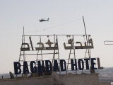 AH-64 Apache in Flight over the Baghdad Hotel in Central Baghdad, Iraq Photographic Print by  Stocktrek Images