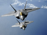 Two F-22 Raptors Fly over the Pacific Ocean Photographic Print by  Stocktrek Images