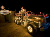 Cougar Mine Resistant Ambush Protected Vehicle Adorned in Holiday Lights Photographic Print by  Stocktrek Images