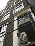 Schnauzer Dog Sitting on Stoop, Amsterdam, Holland Photographic Print by  Keenpress
