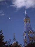 First Quarter Moon Rising Near a Church Steeple, Chile Photographic Print by Marcia Kebbon