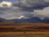 Scenic View of Snow-Capped Mountains, Clouds, and Grasslands Photographic Print by Marcia Kebbon