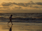Five Year Old Boy Runs Through the Surf, Tybee Island, Georgia Photographic Print by Brian Gordon Green