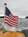 Flag Waves on the Stern of a Maine Made Hampton Yacht, Kennebec River, Bath, Maine, USA Photographic Print by Heather Perry