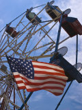 Flag in Front of a Ferris Wheel Against a Summer Sky, New London, Connecticut, USA Photographic Print by Todd Gipstein