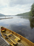 Canoe Floats Next to a Dock, Sebago Lake, Maine Photographic Print by Skip Brown