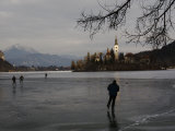 Hockey Players Brave the Cold and the Thin Ice for an Afternoon Game, Bled, Slovenia Fotografie-Druck von Melissa Farlow