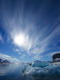 Blue Ice under a Blue Sky with Streaky Clouds, Hornsund, Spitsbergen Island, Svalbard, Norway Photographic Print by Ralph Lee Hopkins